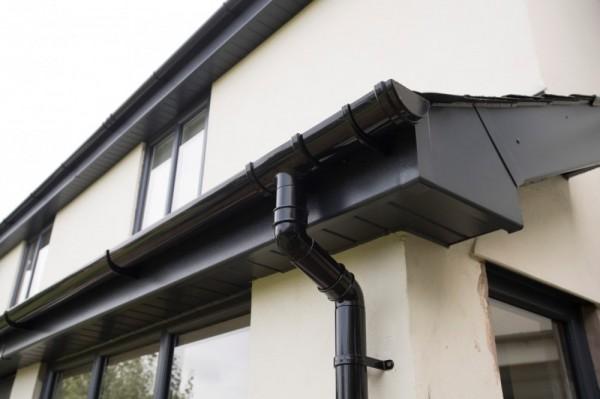 Black fascias,soffits & black round rainwater fittings.