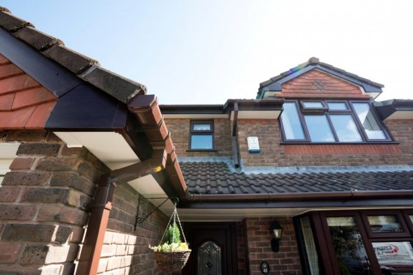 Rosewood fasias,white soffits & brown square rainwater fittings