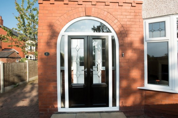 White arched door with black sash