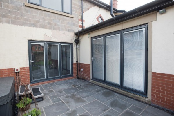 Anthracite grey Aluminum Bi-folding Doors (With integral blinds)