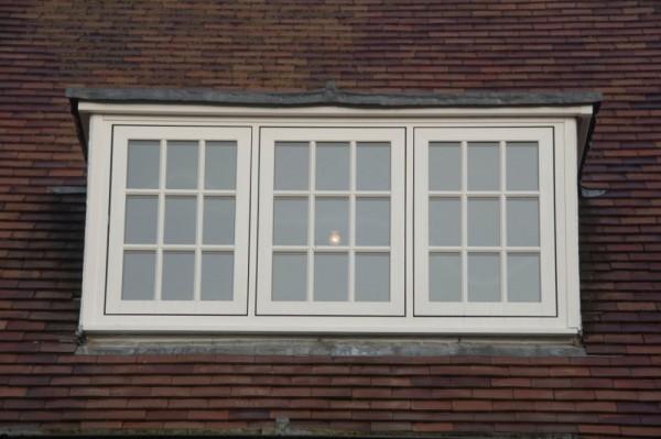 White flush sash  window with astrical bar