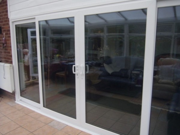 White 4 part UPVC Sliding Patio Door
