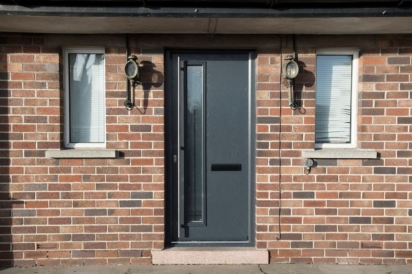 Anthracite grey composite door with stainless steel bar handle