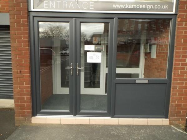 Anthracite grey UPVC entrance frame (Kam kitchens)