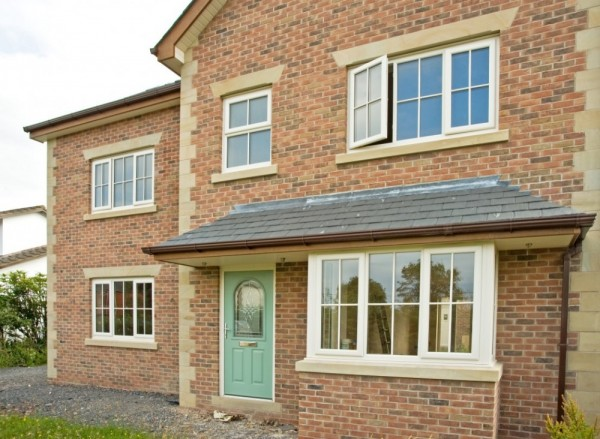 Cream UPVC windows with astrical bar + Chartwell green Composite Door