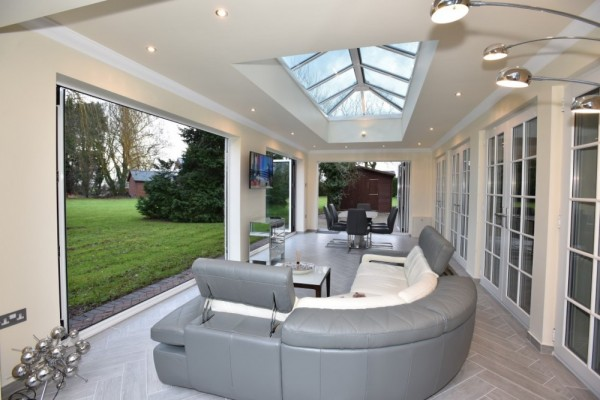 White aluminium Bi-Folding doors with glass lantern roof Orangery