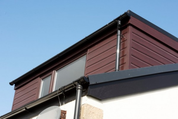 Black fascias,Rosewood weather board,continuous dry verge & black round rain water fittings