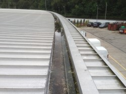 The perimeter box gutter at the Loch Lomond Shores shopping mall began to cause internal leaks to various properties.  We accessed the box gutter, cleaned and prepared the necessary areas prior to undertaking successful Sarnafil repairs.